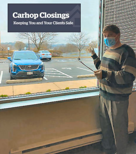 Tom Cullen holding ATG Carhop Closing at Waukesha office photo