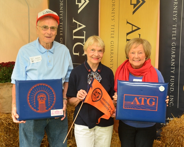 Displaying yesteryear's ATG Illini Tailgate gear are Jim and Nancy Elson with Mary Satter at ATG 50th Tailgate