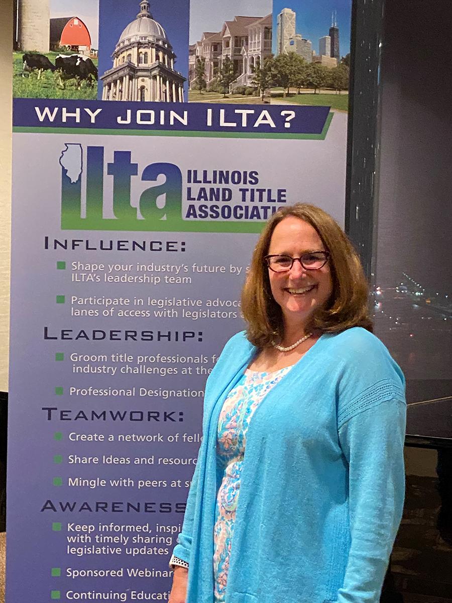 Deb Feinen with ILTA sign