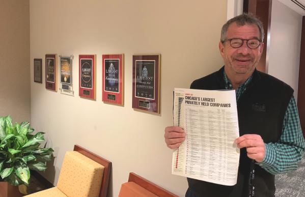 Peter Birnbaum holding issue of Crain's